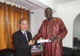 dr bah receiving cheques from ambassador chen