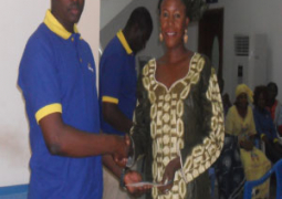 one of the winners receiving her prize