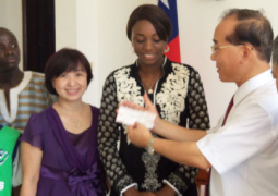 ambassador presents the cheque to minister badjie