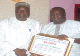 baks touray receiving award from pap saine