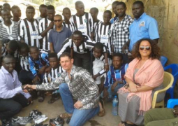 buster and parents pose with blue stars fc