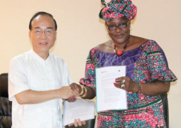ambassador chen exchanging document with ps niang