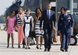 u.s. president barack obama  first lady michelle obama and their daughters sasha l and malia 2nd r walk to air force one at andrews air force base near washington  june 26  2013