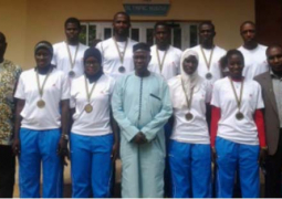 momodou dibba with members of beach volley ball